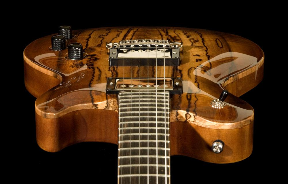Electric #1-  Carved top, set neck, semi-hollow